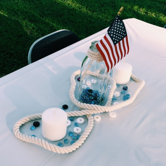 Nautical rope: Michael's, blue glass stones: Michael's, candles: Walmart, glass bottle: milk bottle from the co-op, flag: Family Dollar