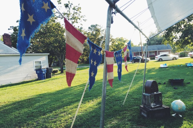 Flag bunting: Pottery Barn (my mother in law's), old radio: yard sale, globe: my mom's, old crates: antique finds