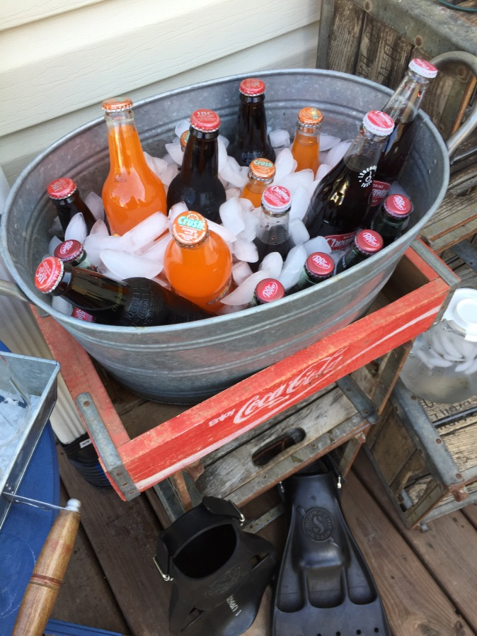 Galvanized drink tub: TJ Maxx, Coca-Cola crate: vintage find, flippers: real Navy Seal combat flippers (gift from a friend)